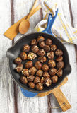 Roasted chestnuts in the pan. Royalty Free Stock Image