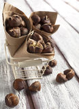 Roasted chestnuts in the paper cone Stock Images