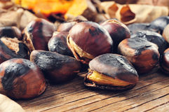 Roasted chestnuts on a rustic wooden table Stock Photo