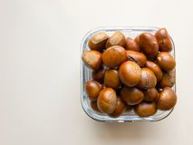 Roasted chestnuts served in a glass dish Royalty Free Stock Images