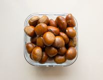 Roasted chestnuts served in a glass dish Stock Photography