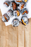 Roasted chestnuts served on white and brown craft paper with cop Royalty Free Stock Images