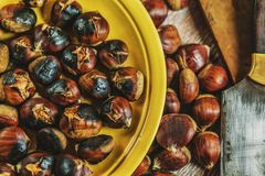 Roasted chestnuts on table stock photography