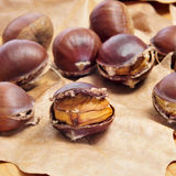 Roasted chestnuts, typical snack in All Saints Day in Catalonia, Stock Photo