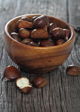 Roasted chestnuts on wooden background Stock Photos