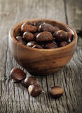 Roasted chestnuts on wooden background royalty free stock image