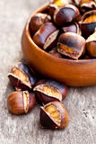 Roasted chestnuts on wooden background Stock Images