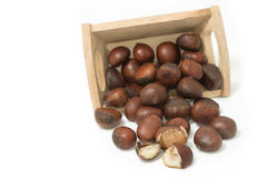 Roasted chestnuts in wooden bowl Stock Photos