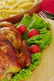 Roasted Chicken. With lettuce, cherry tomatoes, french fries and cutlery (Selective Focus Royalty Free Stock Photo