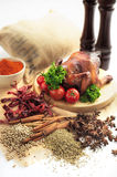Roasted chicken. Presentation of a whole roasted chicken with various spices Stock Photography