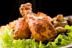 Roasted Chicken. Photo of roasted smoking hot chicken with mushrooms and lettuce royalty free stock photo