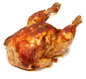 Roasted chicken. Isolated on white stock image