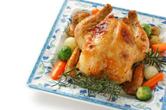Roasted chicken. Oven roasted chicken with vegetables, on white background close up Stock Image