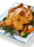 Roasted chicken. Oven roasted chicken with vegetables, on white background portrait Royalty Free Stock Image