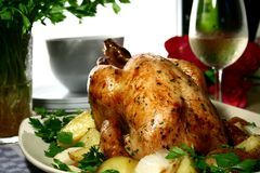 Roasted Chicken. Chicken, roasted with herbs and potatoes stock photo