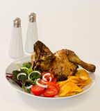 Roasted chicken. With french fries, salad and tomatos Royalty Free Stock Photo