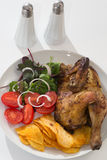 Roasted chicken. With french fries, salad and tomatos Royalty Free Stock Images