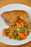 Roasted chicken. With herbs and vegetables on a plate stock image