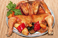 A roasted chicken. With vegetables Stock Images