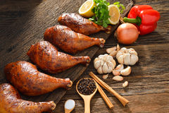 Roasted chicken. With ingredients on wooden table royalty free stock photos