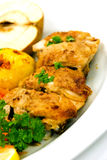 Roasted chicken with apple and fried potatoes Royalty Free Stock Photo
