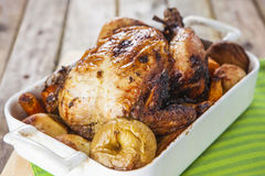 Roasted Chicken with apples and potatoes Royalty Free Stock Image