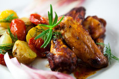 Roasted chicken with baked potatoes Royalty Free Stock Photos