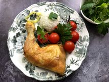 Roasted chicken with basmati rice and cherry tomatoes stock photo
