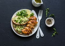 Roasted chicken breast and avocado toast - healthy lunch on a dark background. Top view stock images