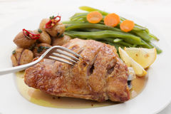 Roasted chicken breast with chestnuts Royalty Free Stock Photo