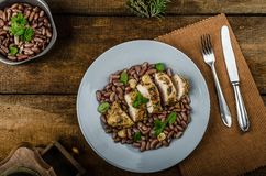 Roasted chicken breast with herbs and stewed beans Royalty Free Stock Photography