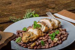 Roasted chicken breast with herbs and stewed beans Stock Photos