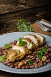Roasted chicken breast with herbs and stewed beans Royalty Free Stock Images