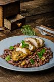 Roasted chicken breast with herbs and stewed beans Stock Image