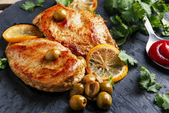 Roasted chicken breast with  lemon Royalty Free Stock Image