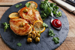 Roasted chicken breast with  lemon Royalty Free Stock Photography