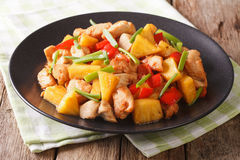Roasted chicken breast with pineapple and vegetables in sweet an Royalty Free Stock Image