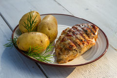 Roasted chicken breast with potatoes Stock Photography