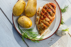 Roasted chicken breast with potatoes and dill Royalty Free Stock Image