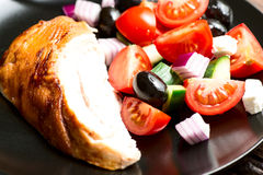 Roasted chicken breast with vegetables in plate close up Royalty Free Stock Photos