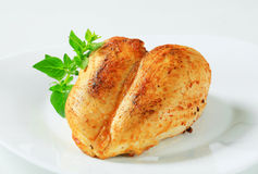Roasted chicken breasts Stock Images