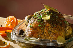 Roasted chicken in casserole dish Stock Photography