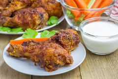 Roasted chicken with celery and carrot sticks, blue cheese dressing and hot sauce Royalty Free Stock Photo