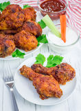 Roasted chicken with celery and carrot sticks, blue cheese dressing and hot sauce Royalty Free Stock Photos