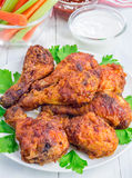 Roasted chicken with celery and carrot sticks, blue cheese dressing and hot sauce Royalty Free Stock Images