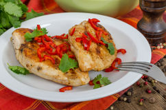 Roasted chicken. With chili pepper Stock Image