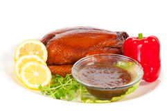 Roasted Chicken for Christmas with chill and Lemon Royalty Free Stock Image