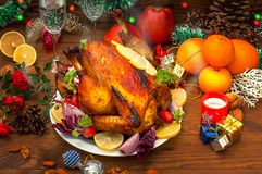 Christmas Dinner. Roasted chicken. Winter Holiday table served. Wooden background. Close-up. Top view stock image