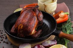 Roasted chicken on wooden background Royalty Free Stock Images