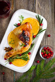 Roasted chicken with cranberry sauce for Christmas dinner Stock Photos